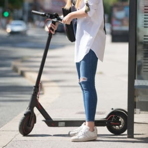Teen girl with her scooter